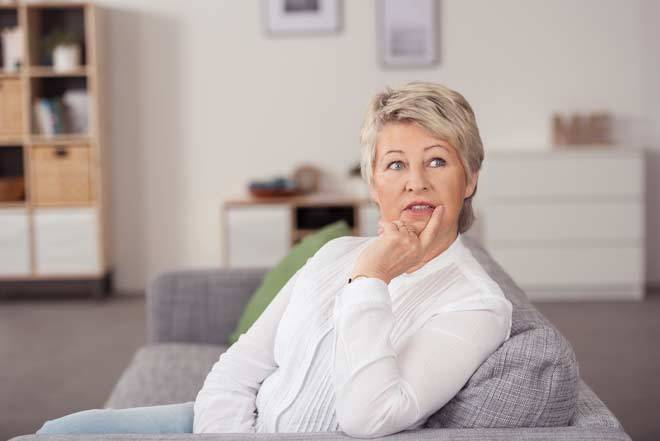 Woman pondering what to ask the divorce attorney