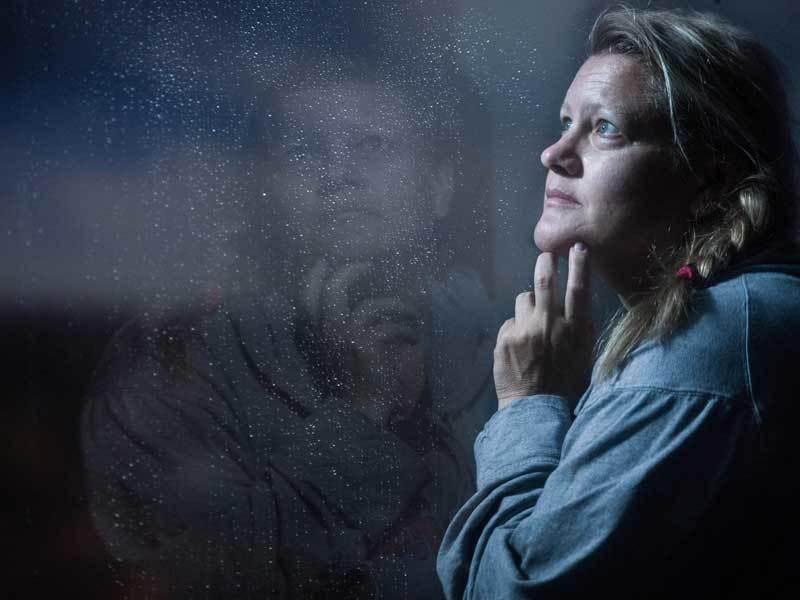 Woman alone worried.